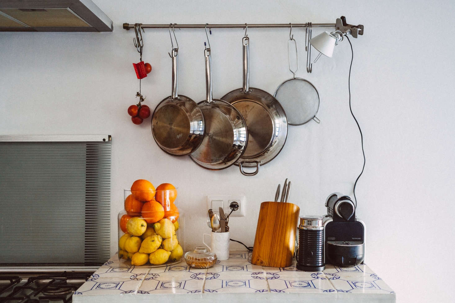 High/low pairings are another Quintana Partners specialty. They clipped an Aluminum Tolomeo Clip Spot Light on the end of a Grundtal Rail. The blue-and-white tiles are made on Menorca.