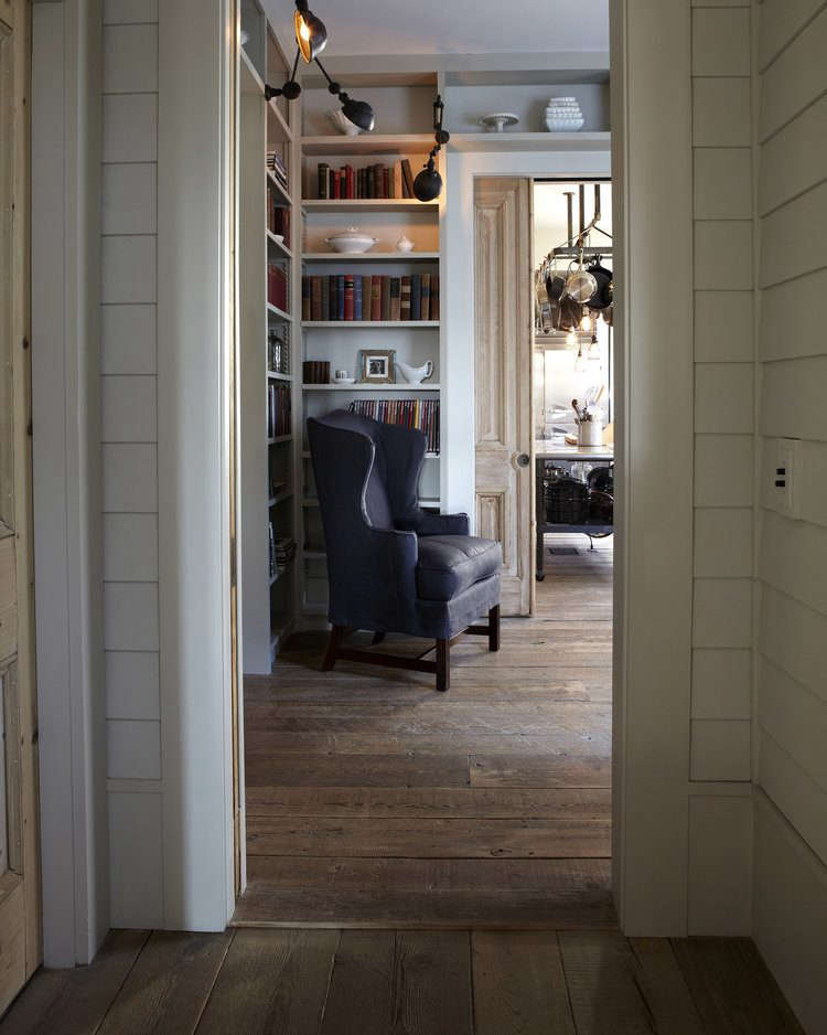A farmhouse sitting room and kitchen usesunfinished Reclaimed Mixed Softwoods.