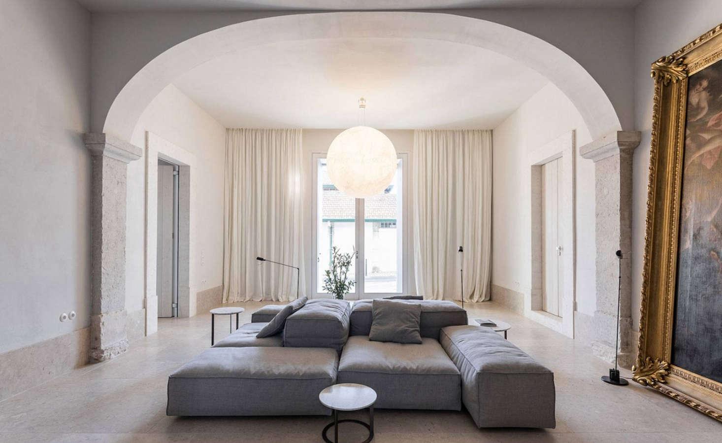 Guests enter through a grand entrance hall anchored bya Moon Pendant byItalian designer Davide Groppi.