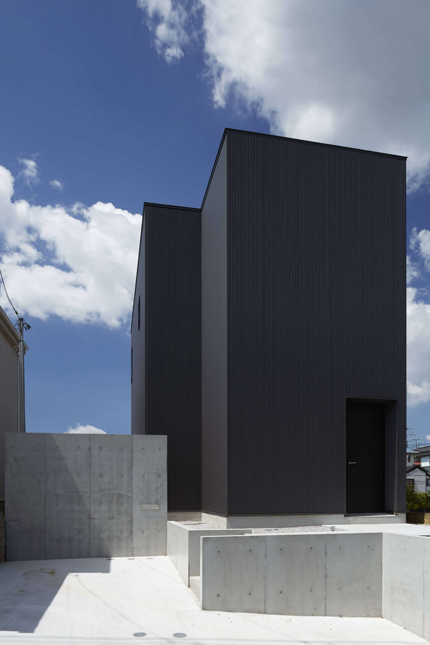Dubbed the Black House, the two-story structure is clad in an industrial corrugated metal paneling known as galvanium,selected, say the designers, &#8