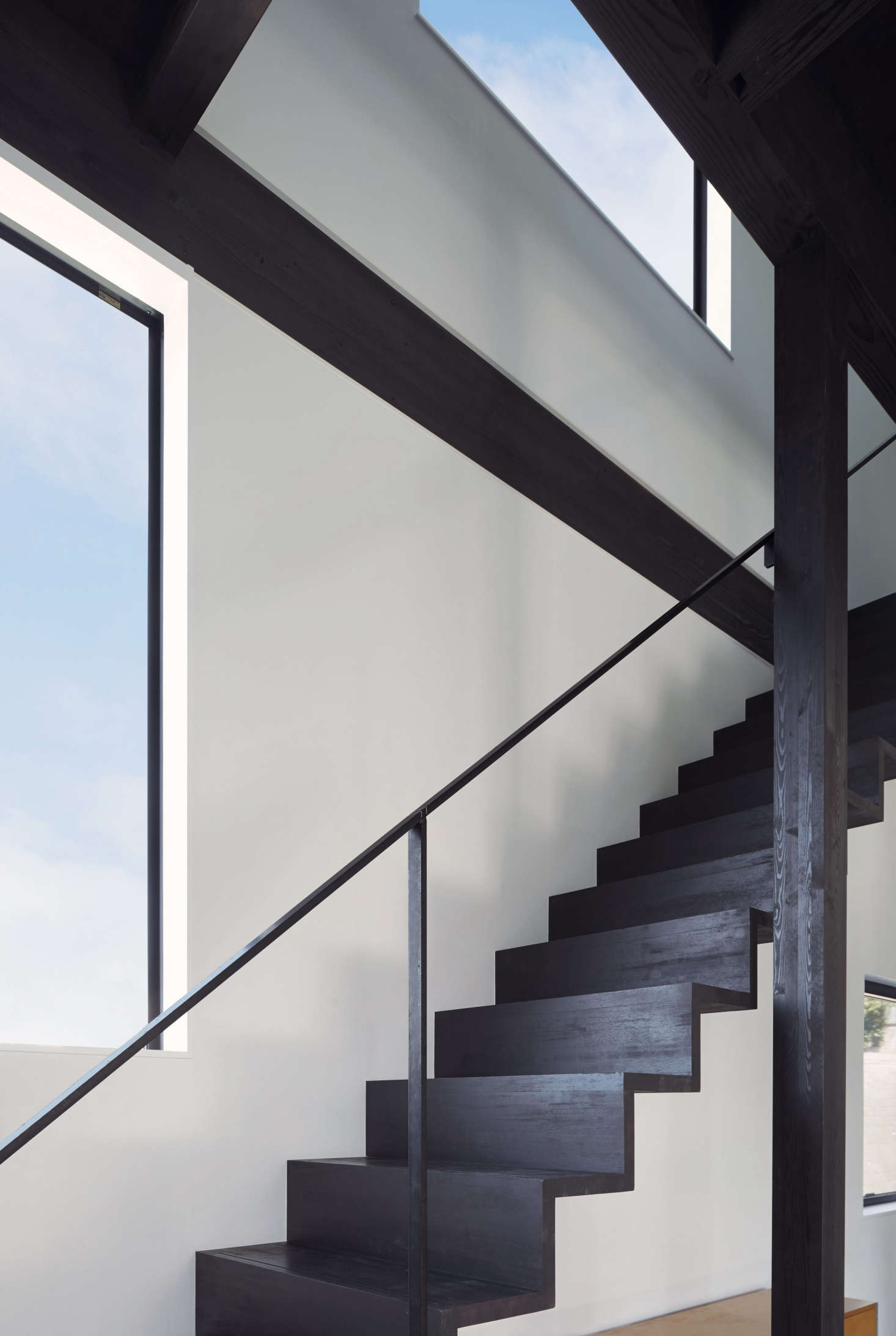 The Douglas fir stairs have a narrow steel railing (yes, it passed code). As for the safety question: &#8