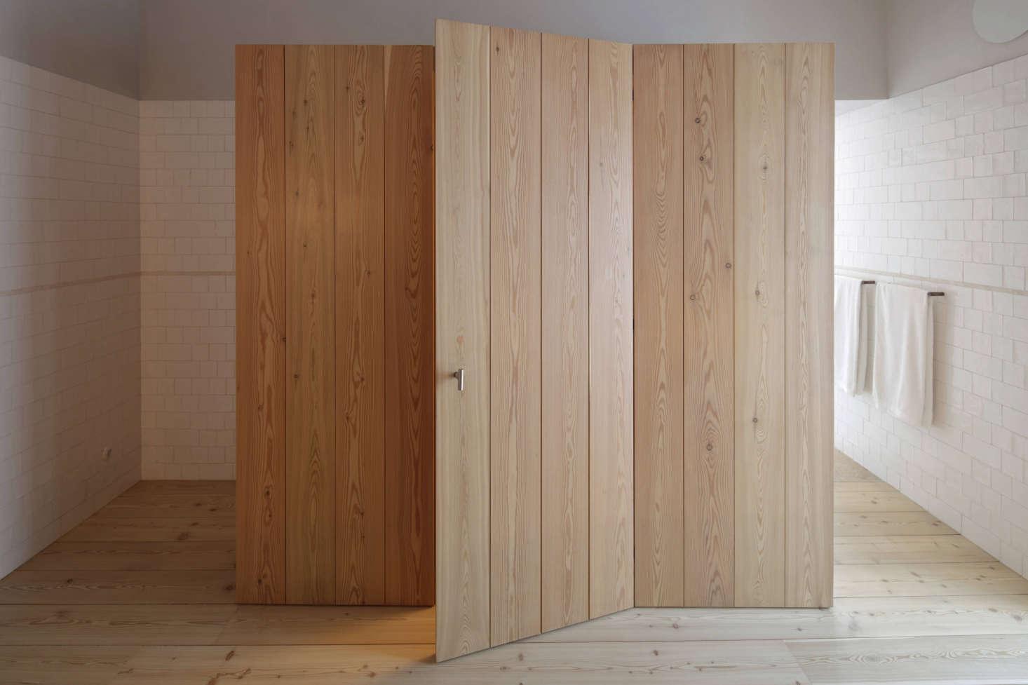 A custom oak closet near the bathroom.