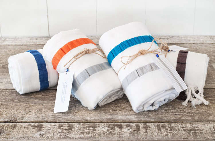 The 8 Knots Seersucker Stripe Towel, 36 by 70 inches, is made from Aegean cotton and finished with hand-knotted tassels. They're available at 8 Knots for $196 for a set of four different colored towels. They're also available at Indigo Cotton for $50 each.