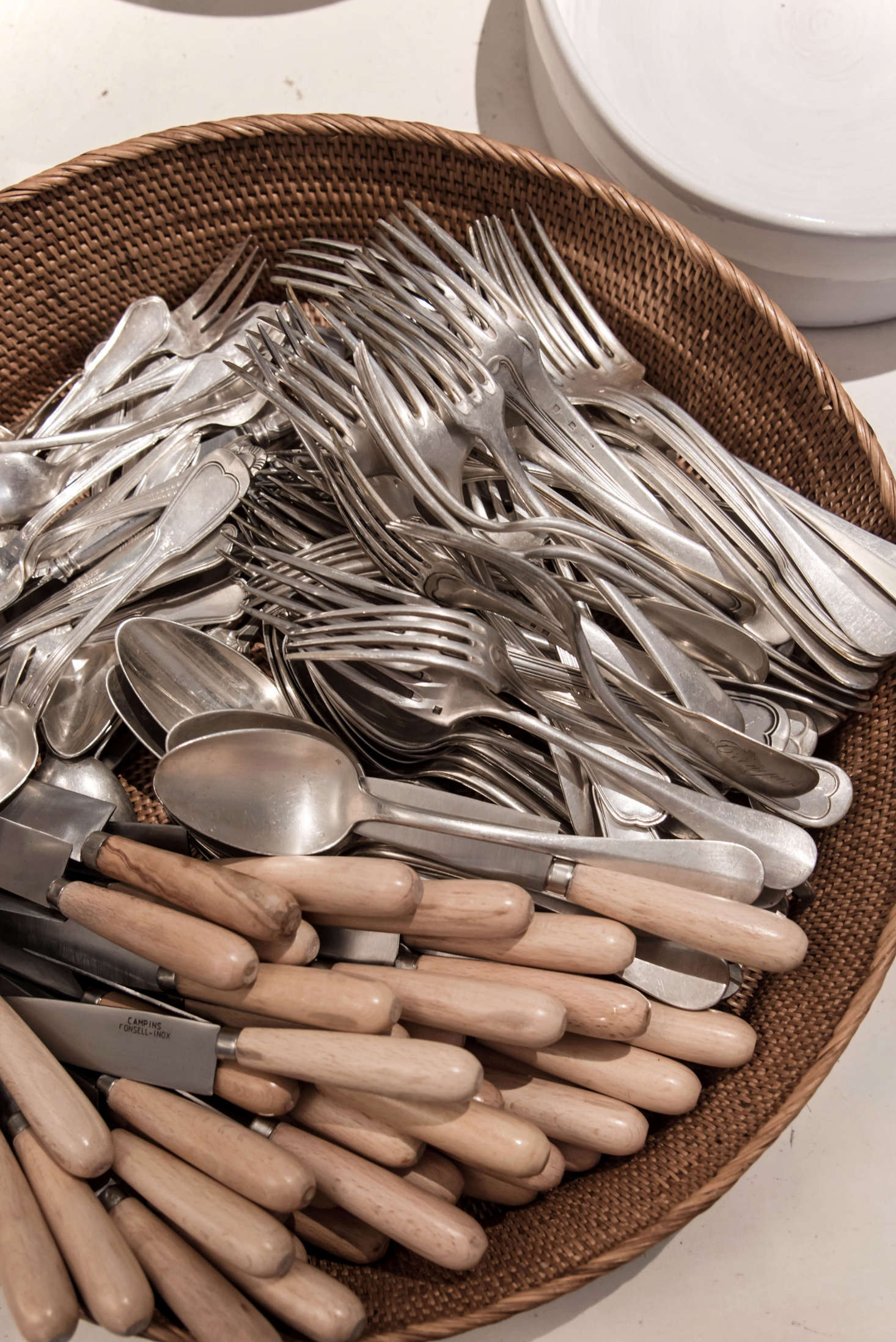 Seek out beautiful flatware for daily use. Here, knives handmade by an artisan in Mallorca mingle with mix-and-match silver.
