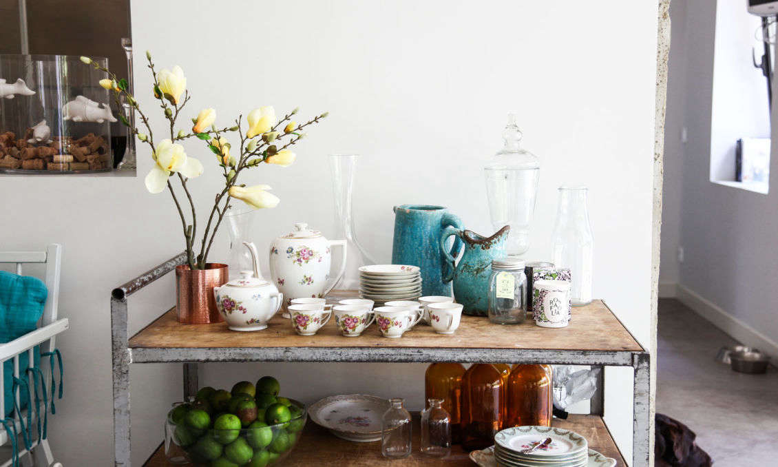 Rugged mixeswell withrefined: In the dining area, Prudent put a metal factory cart to use asa tea service table.