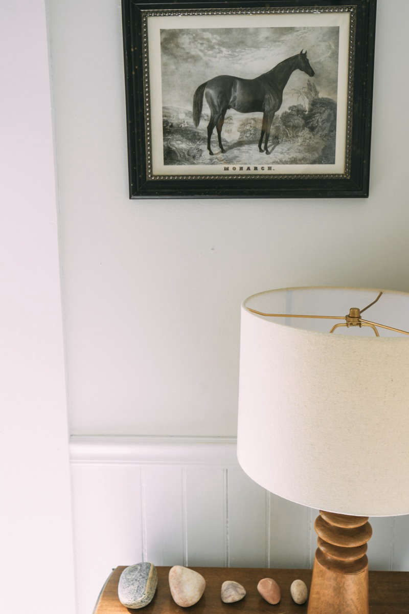 A vintage horse print and collected stones, arranged artfully.