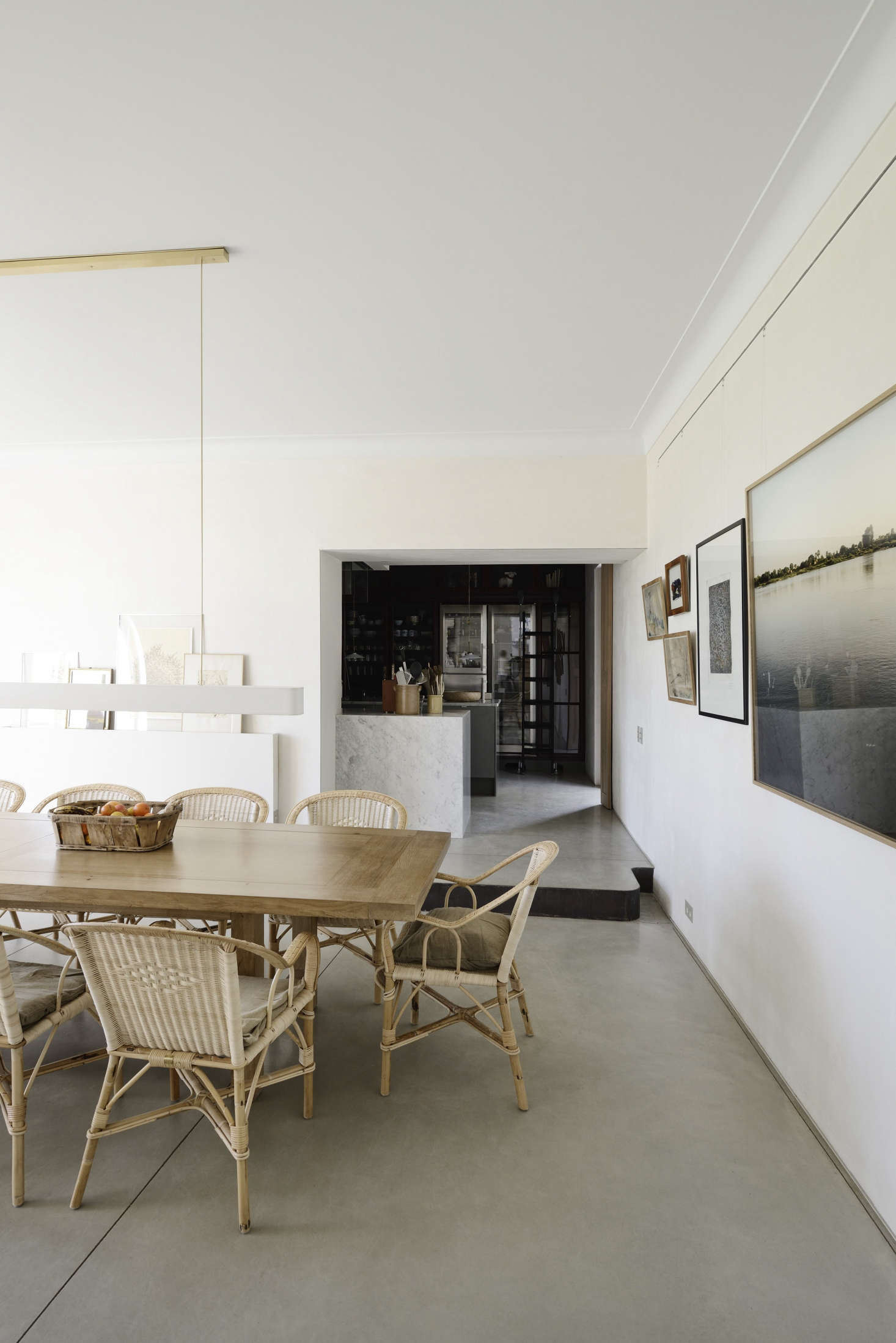 One Side Of The Dining Room Features Artwork Propped On A Ledge While The  Other Utilizes