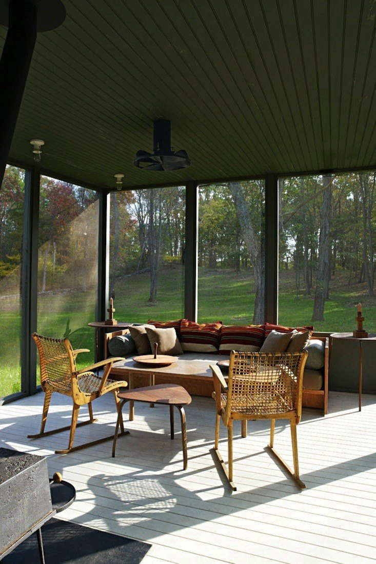 Architects Calvin Tsao and Zack McKown's screened porch at their weekend place in Rhinebeck, NY. (For sourcing ideas, see Steal This Look: The Perfect Screened Porch) Photo by Richard Powers for Tsao & McKown. Architects.