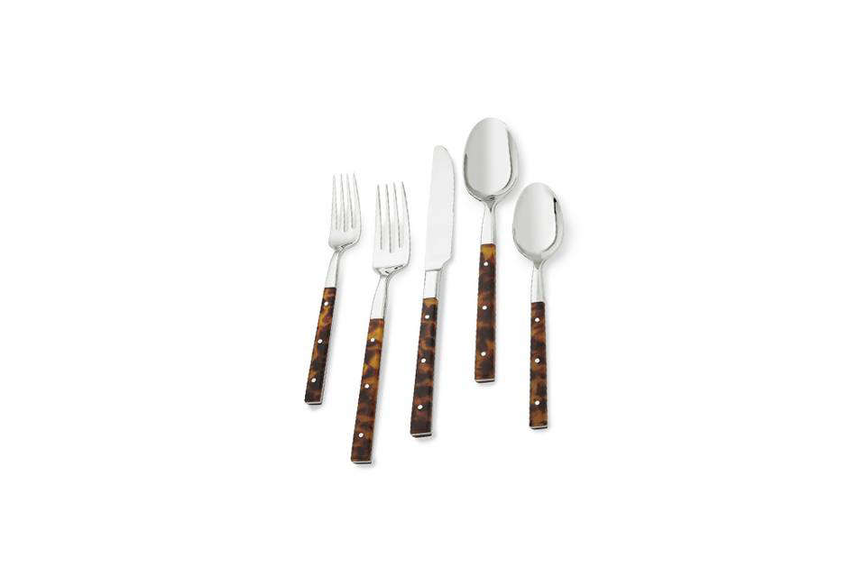 The Argent Orfévres St. Lauren 5-Piece Place Setting with tortoise shell printed resin handles; $0 for the set at Williams-Sonoma.