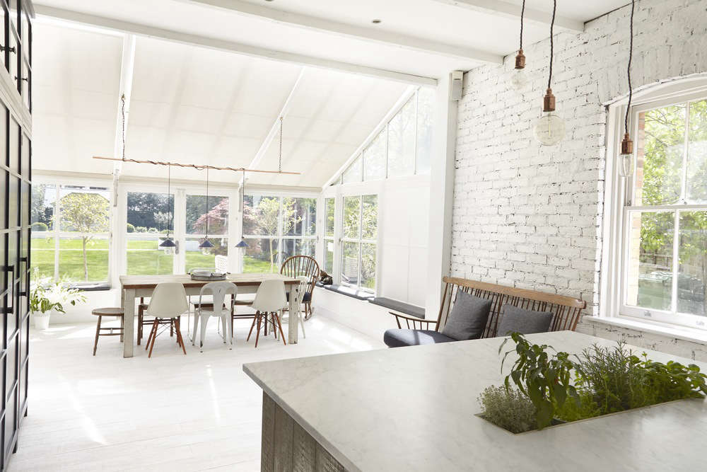 The bright kitchen opens out onto a green backyard in Beckenham, on the outskirts of London. Photograph courtesy of Blakes London.