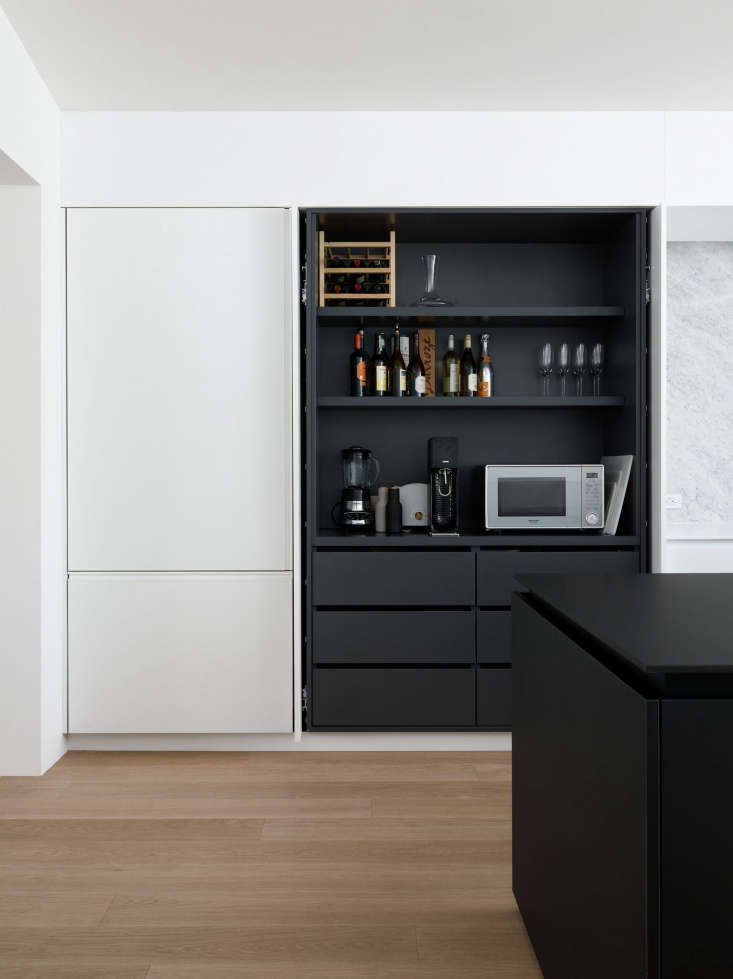 disappearing act: 14 minimalist hidden kitchens - remodelista