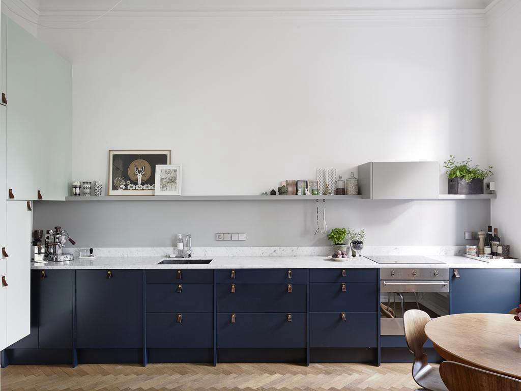 A Kitchen In Sweden With Dark Blue Painted Cabinets And Leather Cabinet  Pulls Featured On Swedish