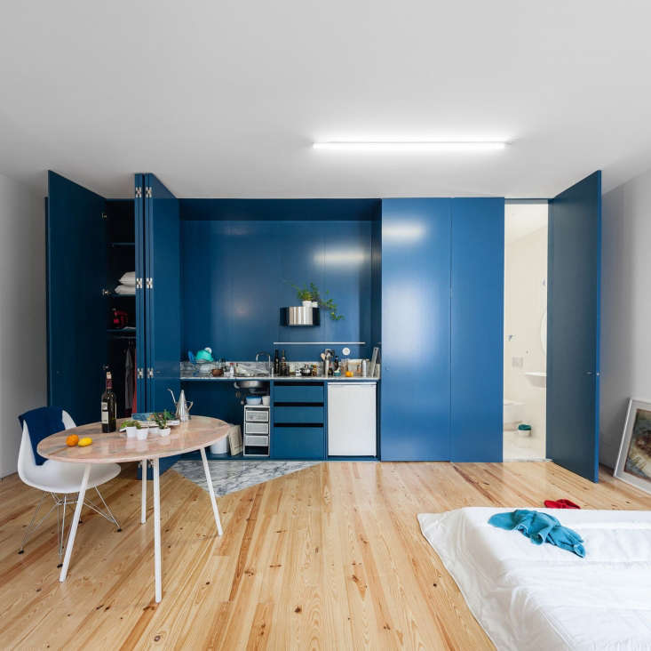 Porto Apartment With Blue Hidden Kitchen By Fala Atelier