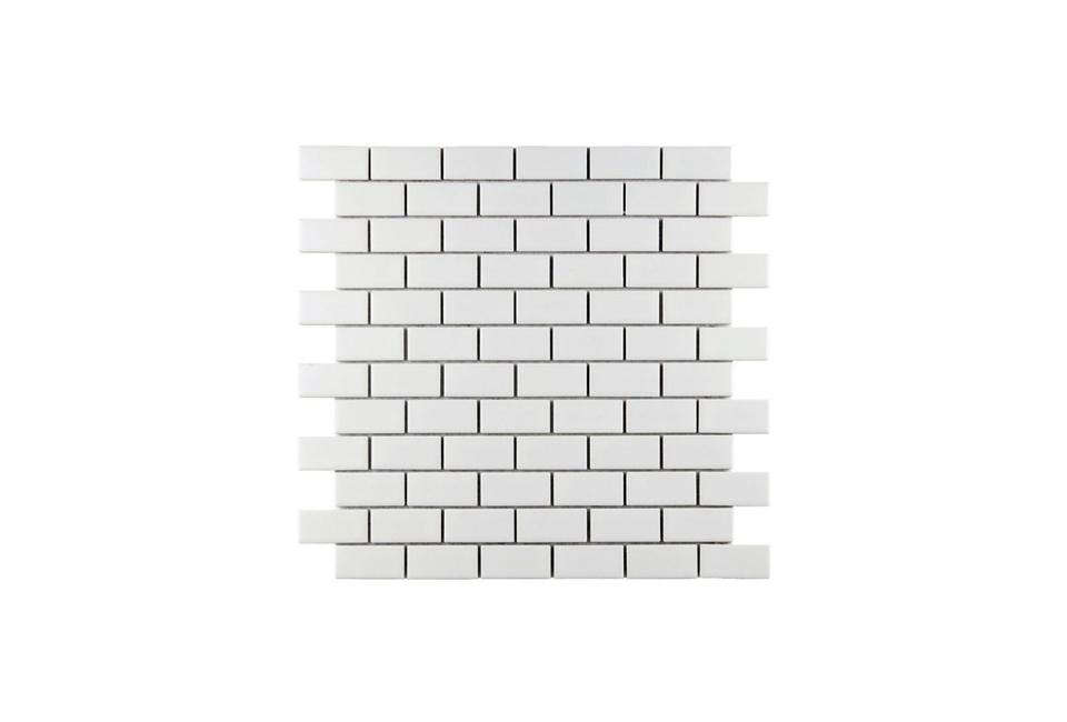 The cupboard's Metro White Matt Flat Wall Tiles came from Tons of Tiles in the U.K.; £0.32 (50 cents) per tile. Home Depot sells miniature one-by-two-inch Metro Subway Matte White Wall Tile, shown, for $5.95 per square foot, and two-by-seven-inch Metro Soho Subway Tile Glossy White for $6.97 per square foot. For a top-of-the-line, handmade version, consider Heath Ceramics Modern Basics tiles. Subway tiles can be patterned in a number of ways; see our White Tile Pattern Glossary.