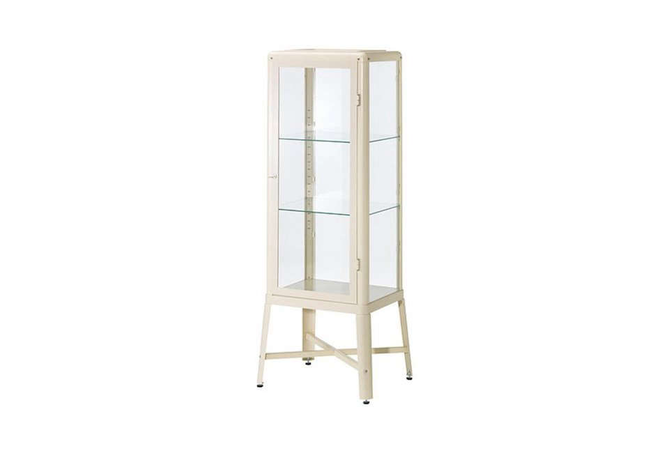 Ikea's Fabrikör glass-door cabinet of powder-coated steel with adjustable glass shelves is currently on sale for $169, marked down from $199. It's shown in beige and also comes in dark gray and red-brown.