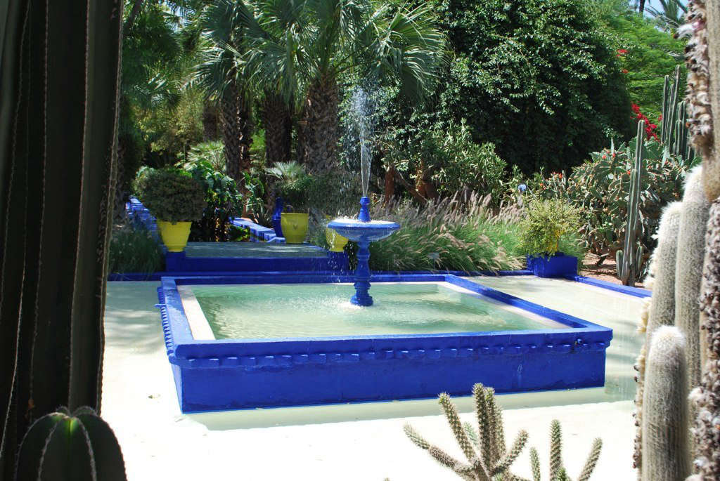 And one from Gardenista: At his Jardins Majorelle home and gardens in Morocco, Yves Saint Laurent painted fountains, pathways, even the house's exterior in an homage to the original Yves. Photograph from10 Garden Ideas to Steal From Morocco.