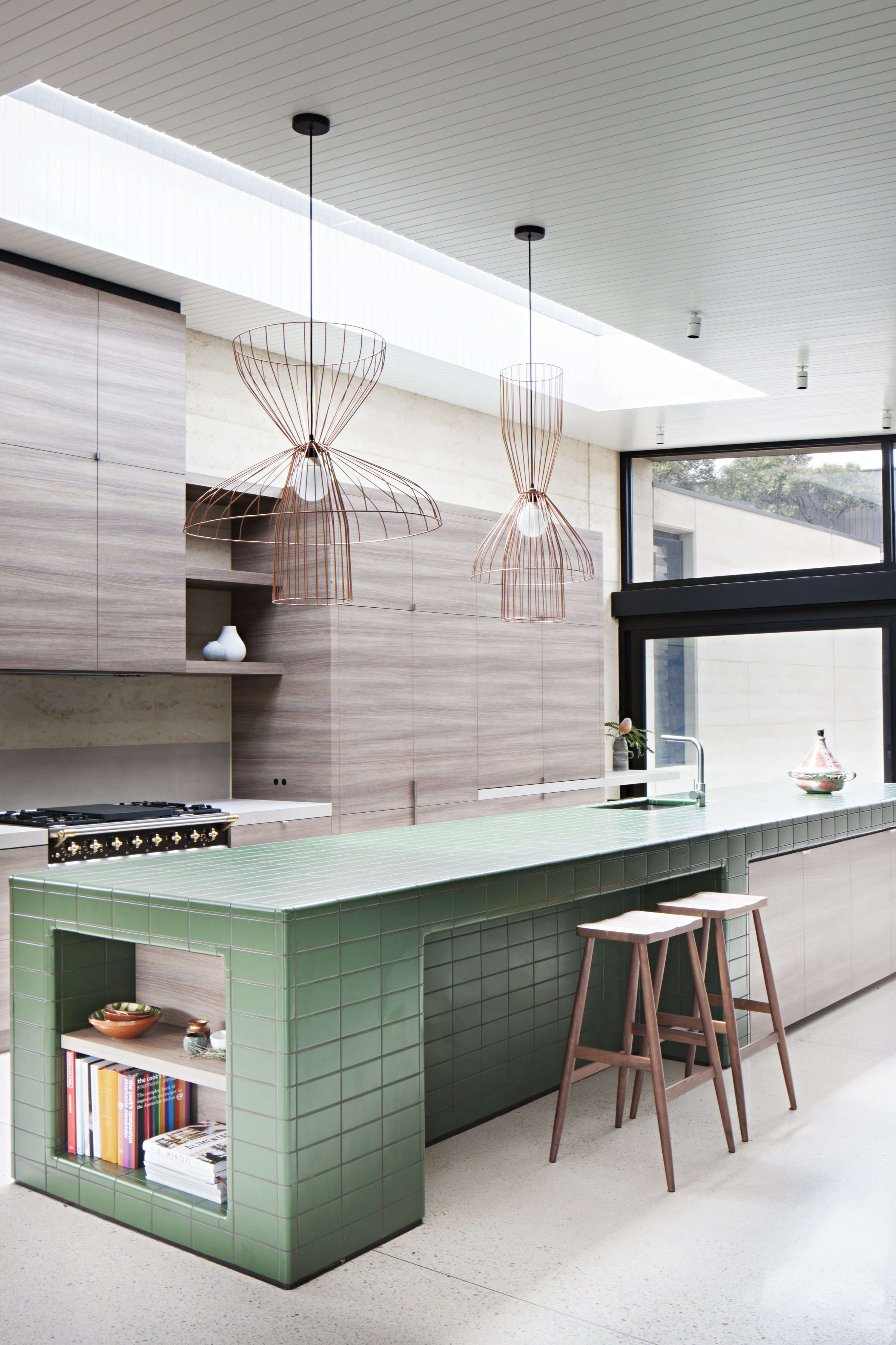 Tiled kitchen island in contemporary wood kitchen at Layer House by ...
