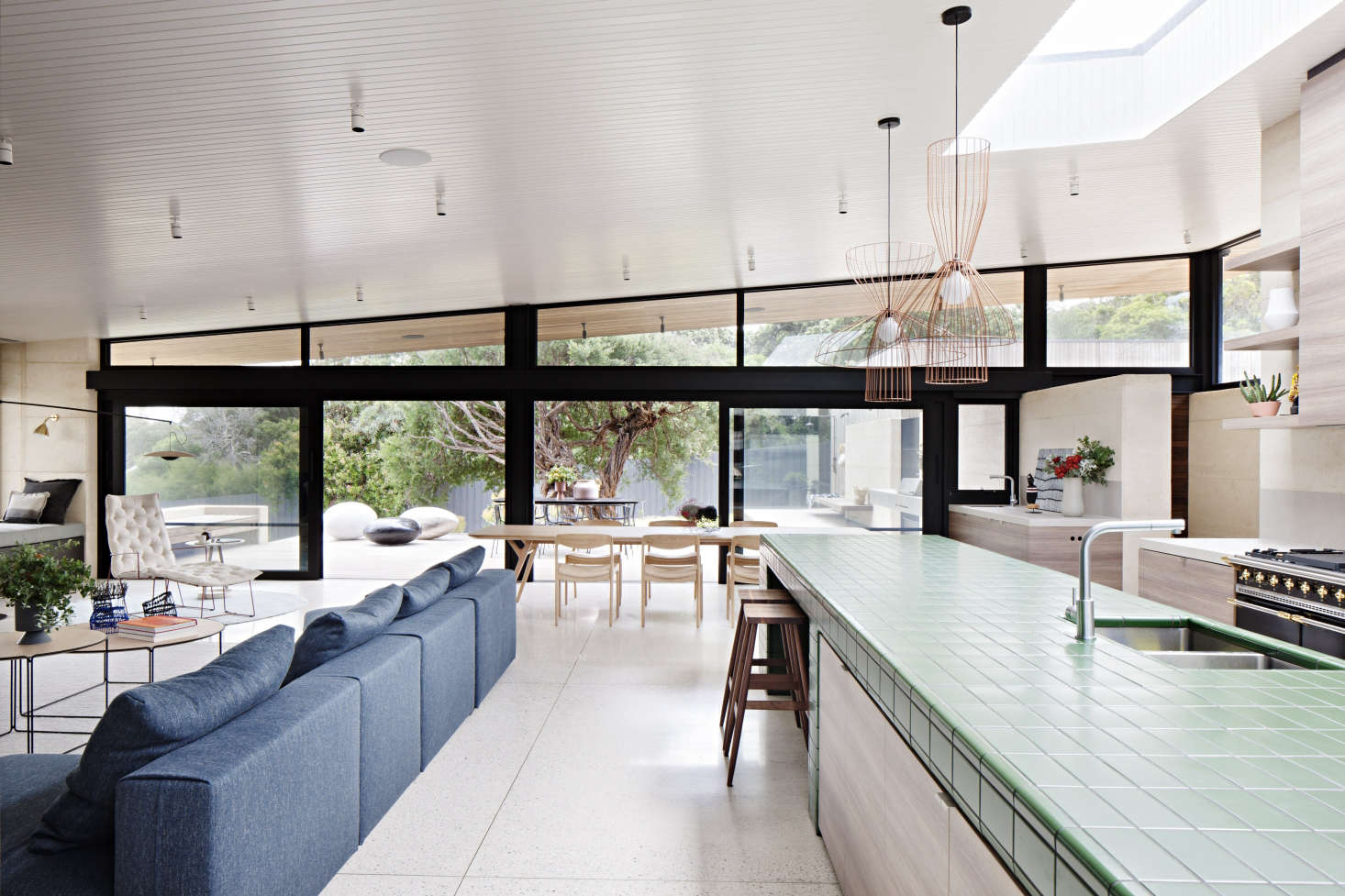 Tiled Kitchen Island In Contemporary Wood Kitchen At Layer House By - Tiled kitchen island