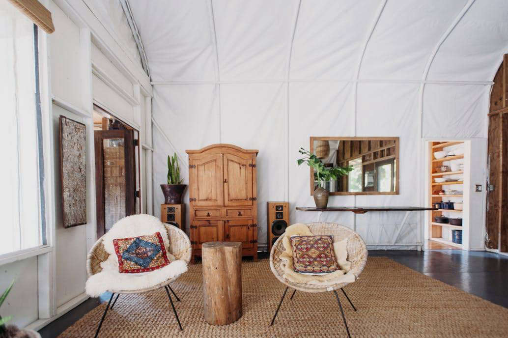 u201cA pair of vintage hoop chairs are adorned with sheepskin and vintage kilim pillows. & Best Amateur Living/Dining Space: A World Traveleru0027s Living Room ...