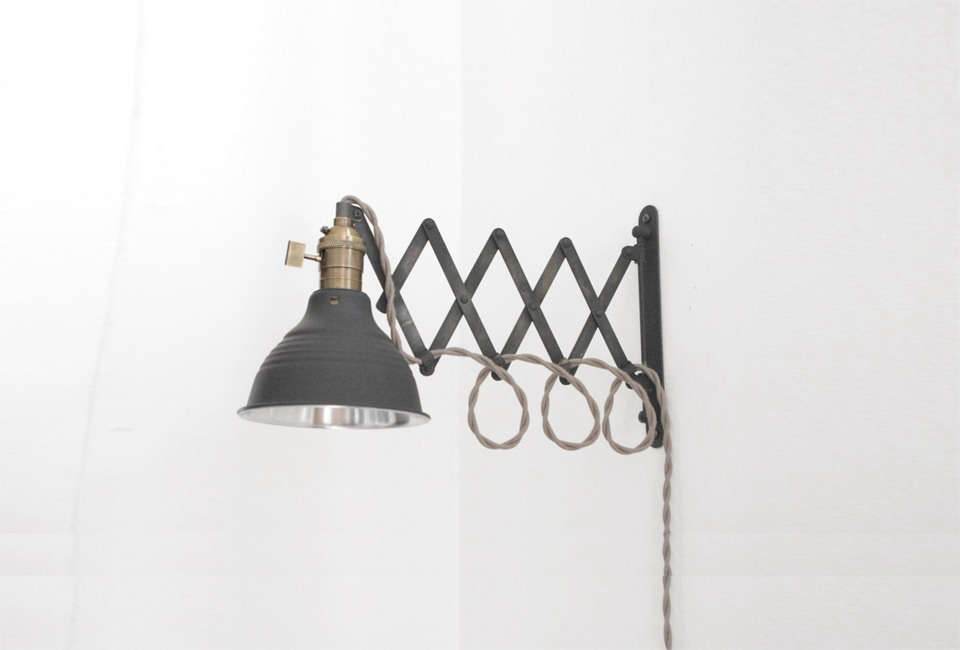 Industrial Scissor Wall Lamps were sourced from Etsy seller Long Made Co. of Houston; $175 each. For more of their work, see our post The New Industrials.
