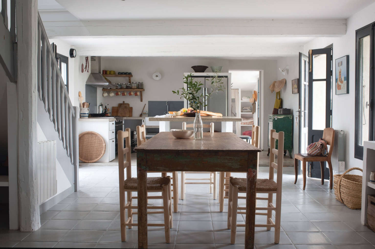 modern farmhouse dining room and kitchen at the modern farmhouse kitchen at mas maroc amanda