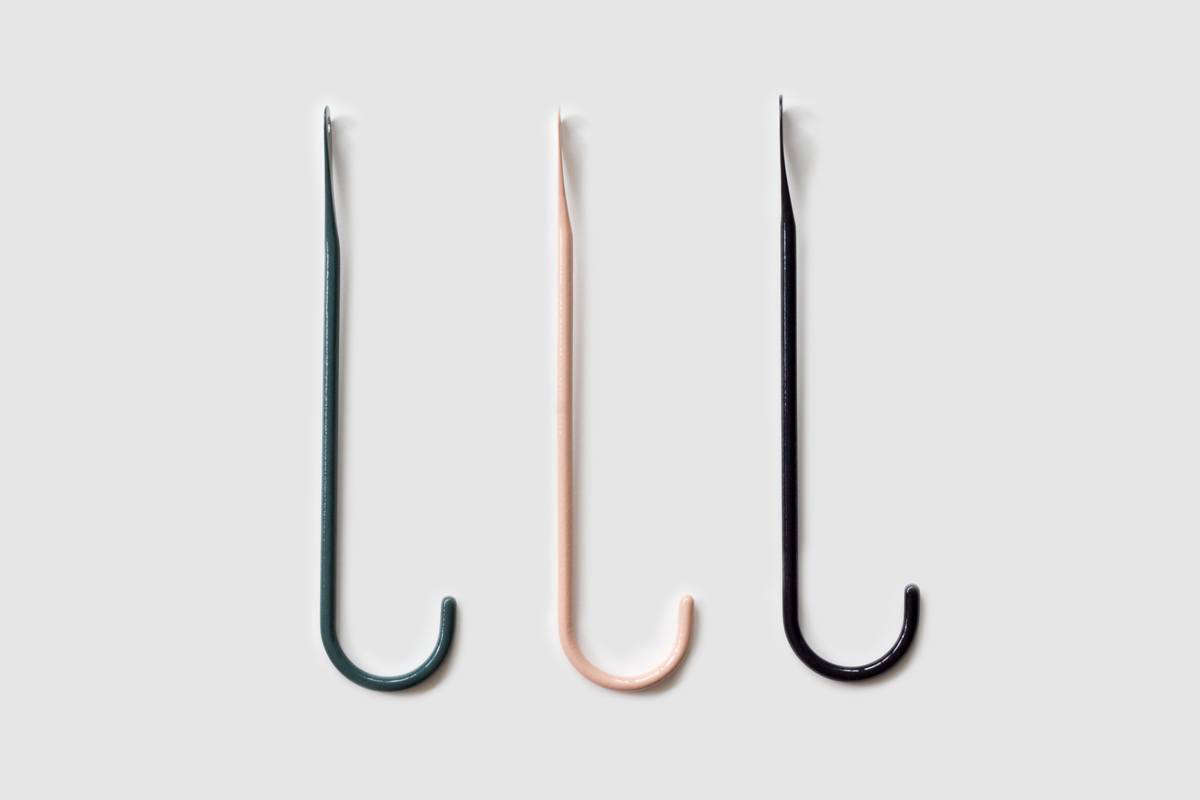 The Bite Hook—in Dark Green, Pink, and Black—is CHF 45 ($46 USD) each.