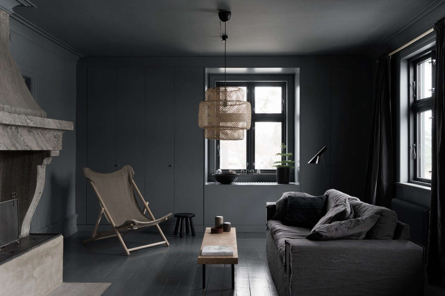 Dark Gray Paint Surrounds The Living Room From A Painted Wood Floor To Walls