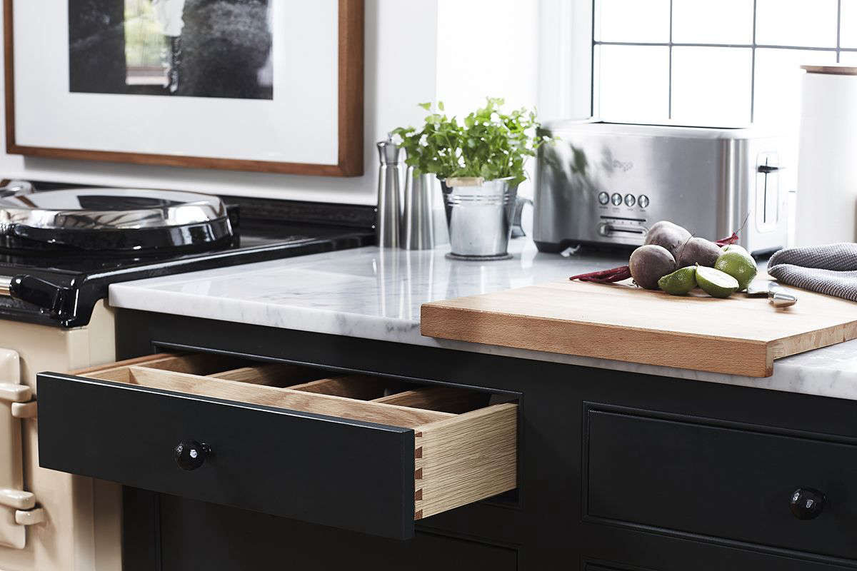 Q: What solutions did you find to your design problems? A: Our main problem  was incorporating enough storage (which we solved with large integrated  larder ...