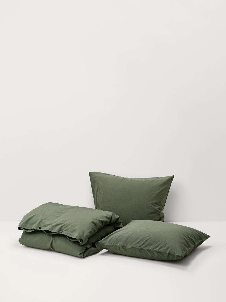 The Stone-Washed Cotton Olive Green Bedding by Artilleriet comes in pillow shams, 5 SEK ($33.src=