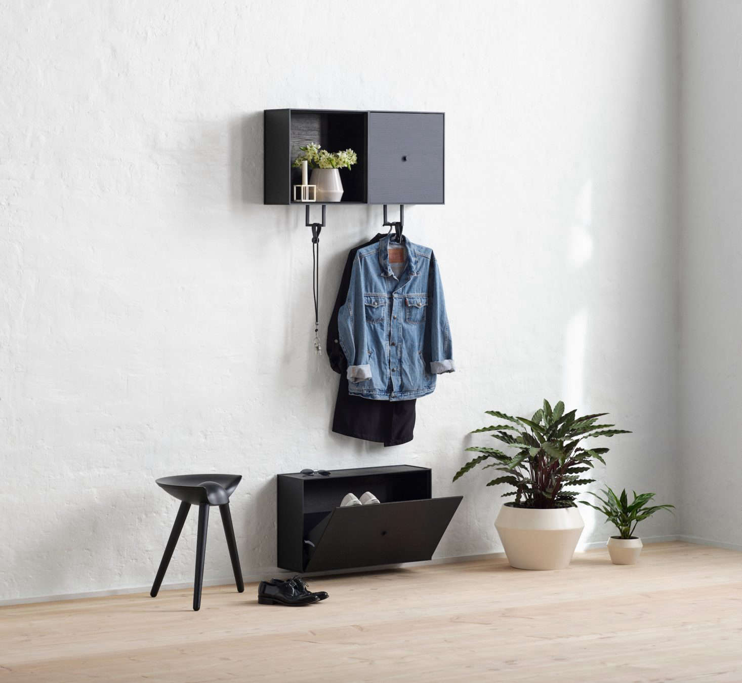 New Frame Rails, available in three sizes, attach to the bottom of the Frame storage cabinets. Also new to the collection: the Frame Hanger and leather Stropp Loop, for hanging coats and clothes from the rails.