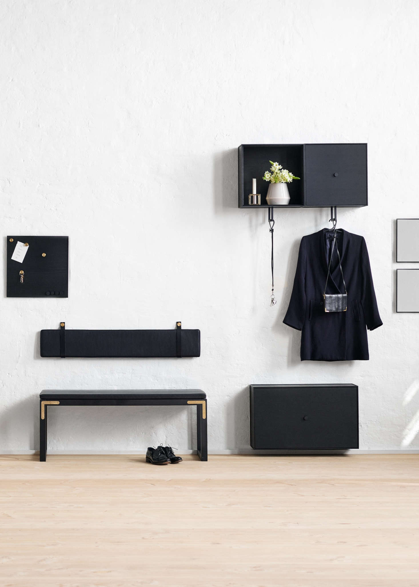 Also pictured are wall-mounted cabinets from the Frame storage lineand a black Remind Message Board.