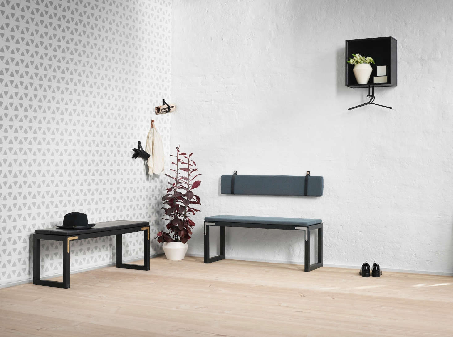 The collection is endlessly customizable. Here, two Conekt benches and a scattering of Stropp leather loops form an artful sitting area.