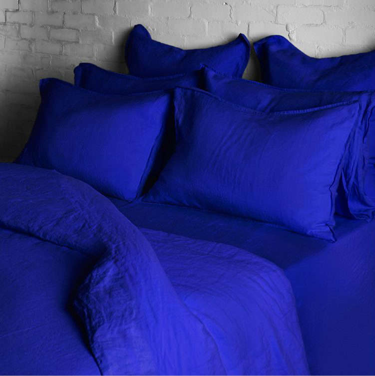 Linen sheets have been trending for a while now, but we're starting to see them in more nervy colors (thanks to Merci), like these Workwear Blue Bed Linens at Conran Shop in the UK. Bill Cunningham and Yves Klein would have approved.