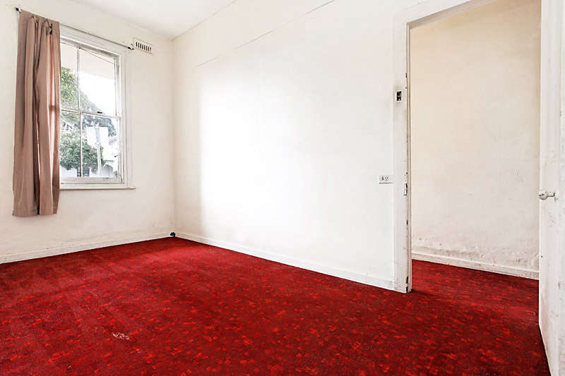 What's now the living room was an enclosed bedroom with plush red carpet.