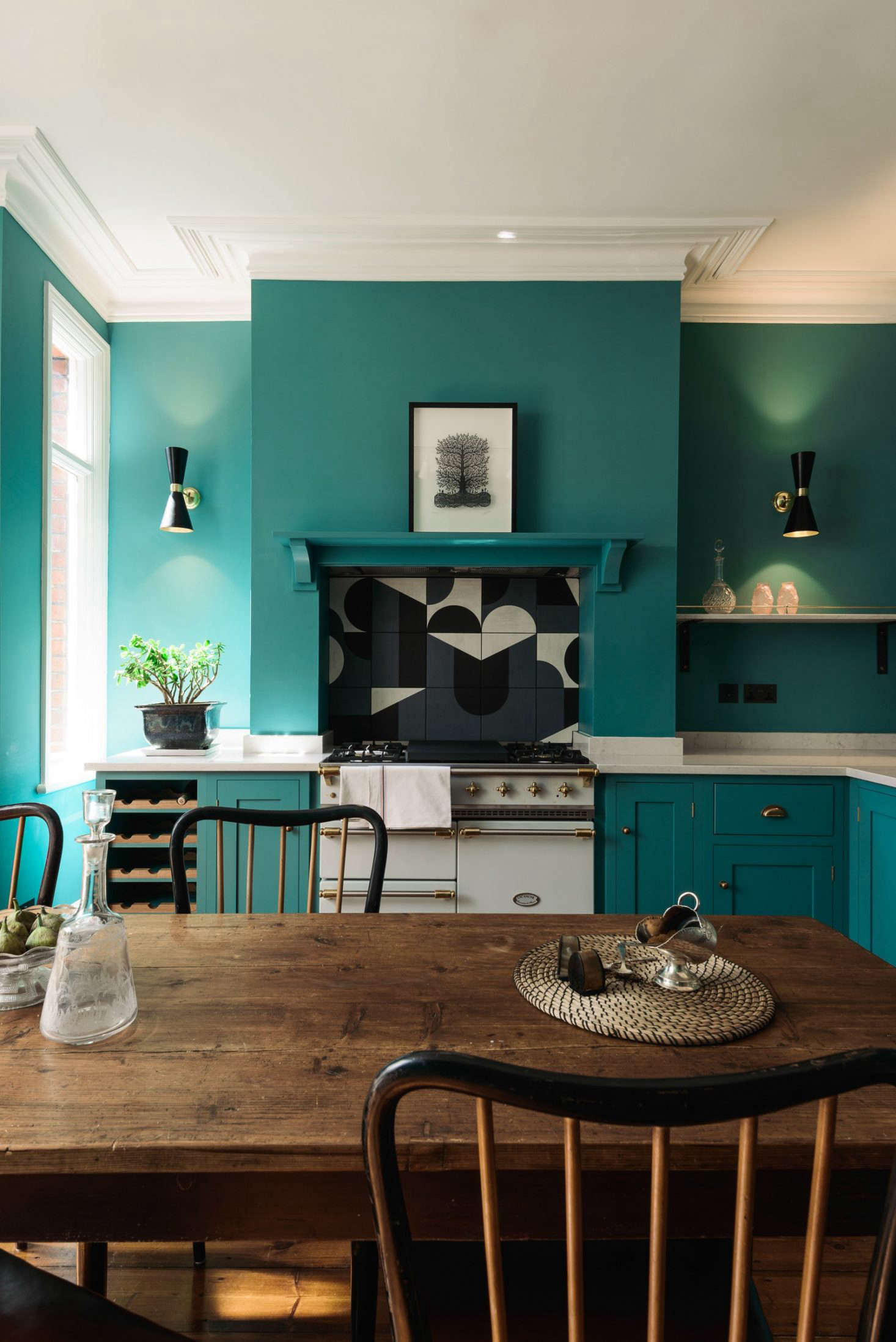 Shaker-style deVol kitchen in London with statement tiled backsplash