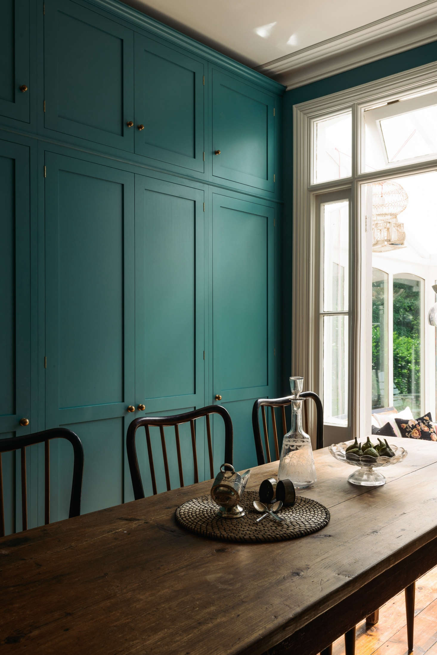 Shaker-style deVol kitchen in London with statement tiled backsplash