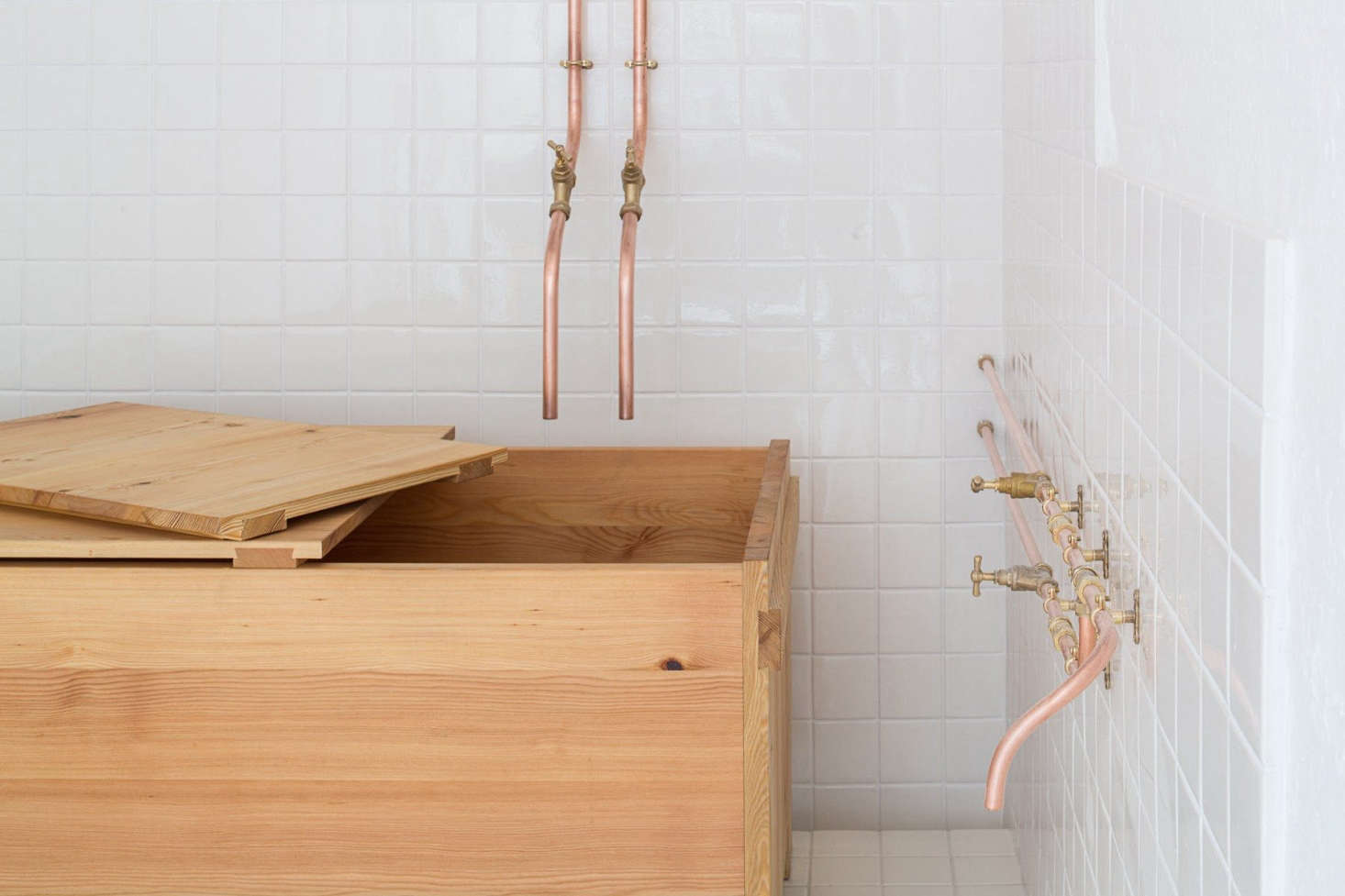 The tub is theBadbox from Studio Anna van der Lei. It's made from larch wood that is treated with a colorless and odorless mineral oil. Studio Anna van der Lei works closely with each client to create the right tub. For more, see our postThe Home Spa Reimagined, from a Dutch-Finnish Designer.