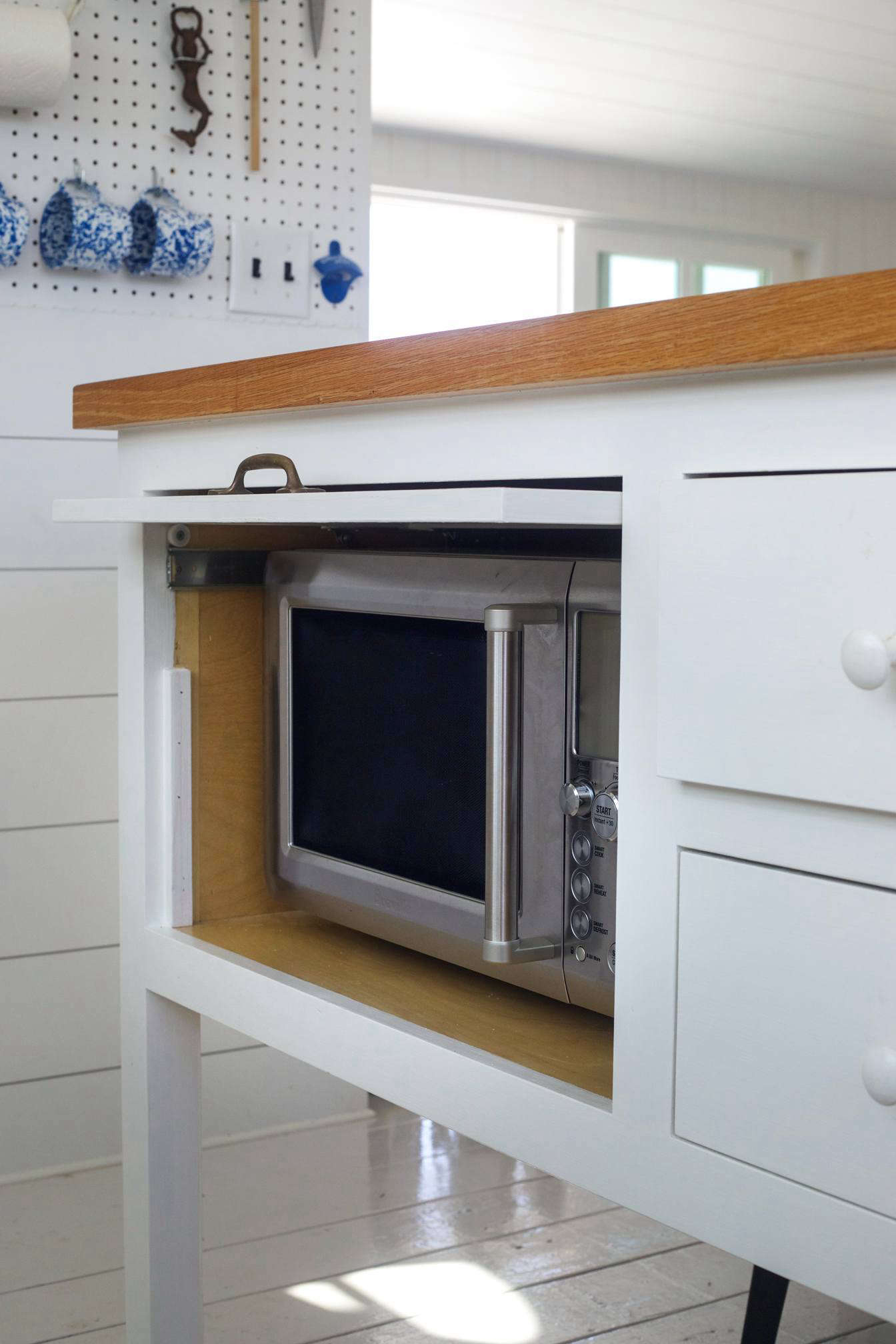 A Microwave Concealed In The Kitchen Island With A Retractable Door At The  Cape Cod Beach