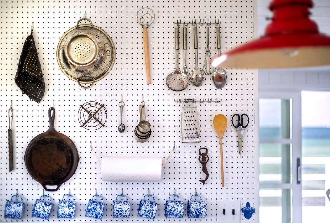 Another pegboard—this one in Falmouth, Massachusetts—displays a wooden spoon among other similarly low-fi utensils. Photograph by Justine Hand from A Shipshape Cape Cod Cottage Inspired by Wes Anderson's 'The Life Aquatic.'