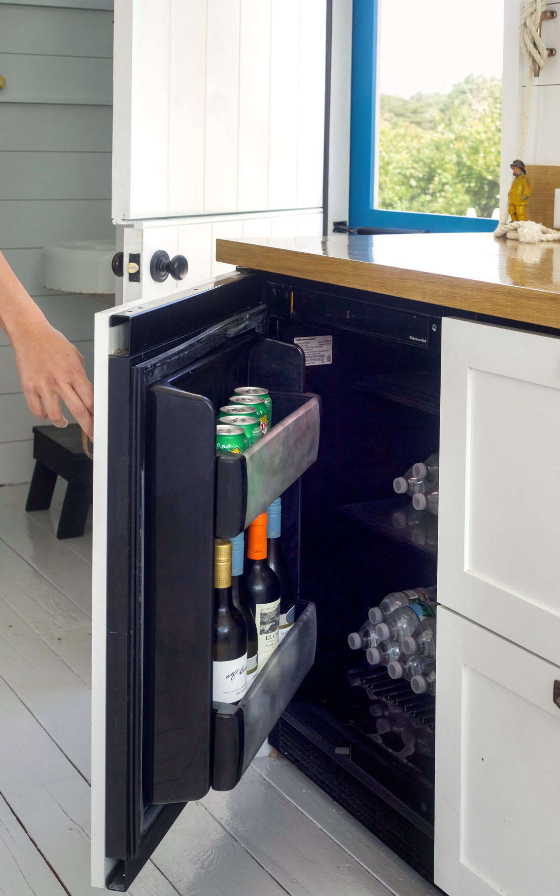 A Kitchenaid 24-Inch Panel Ready Undercounter Refrigerator serves as a mini drinks refrigerator.