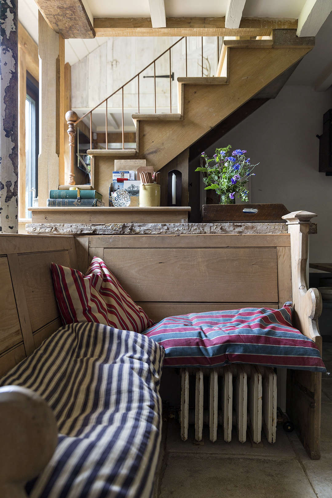 A stairway leads to the loft sleeping areas of the barn.