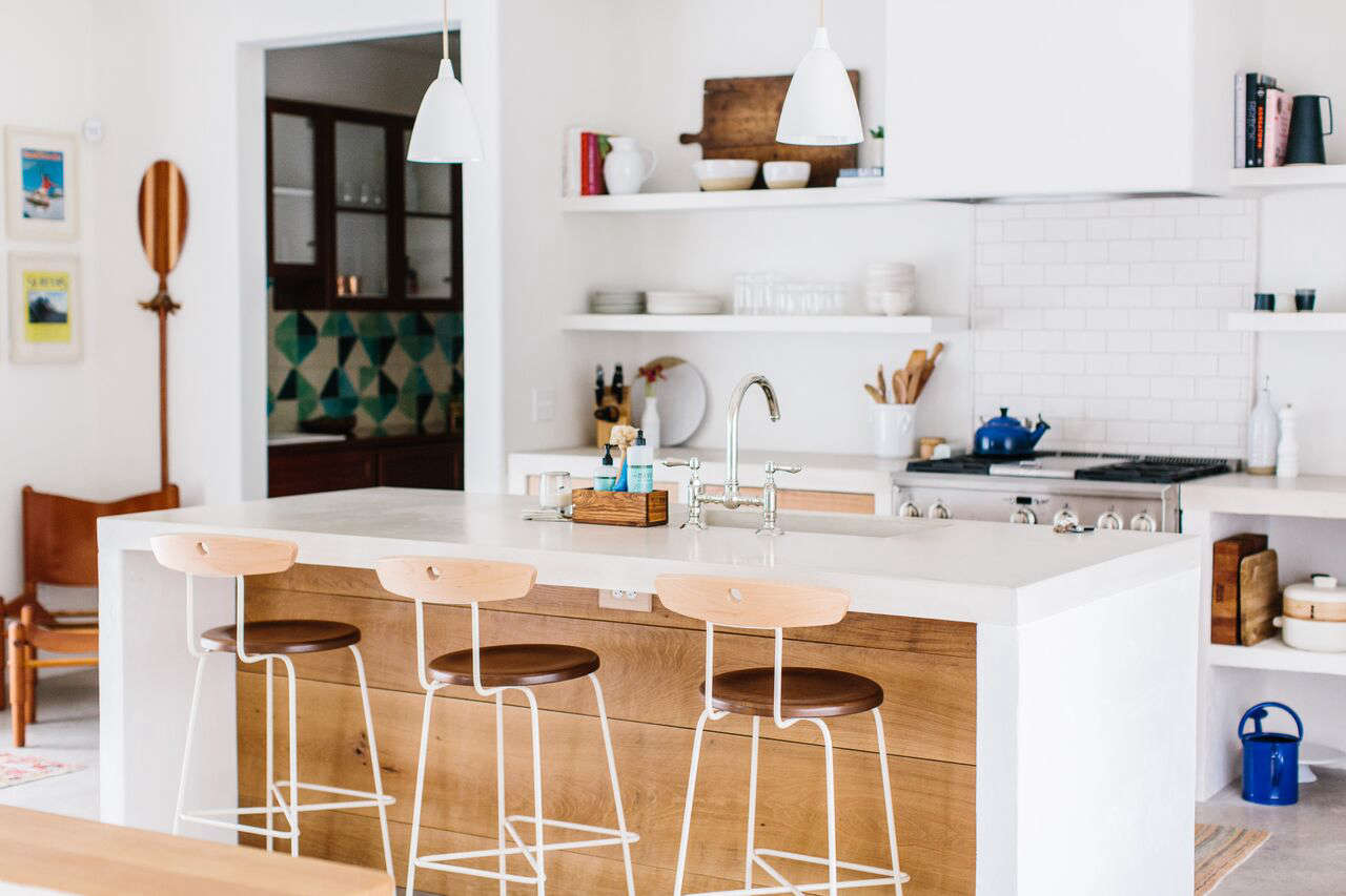 Three LostineAnna Stools are perched at the kitchen island.