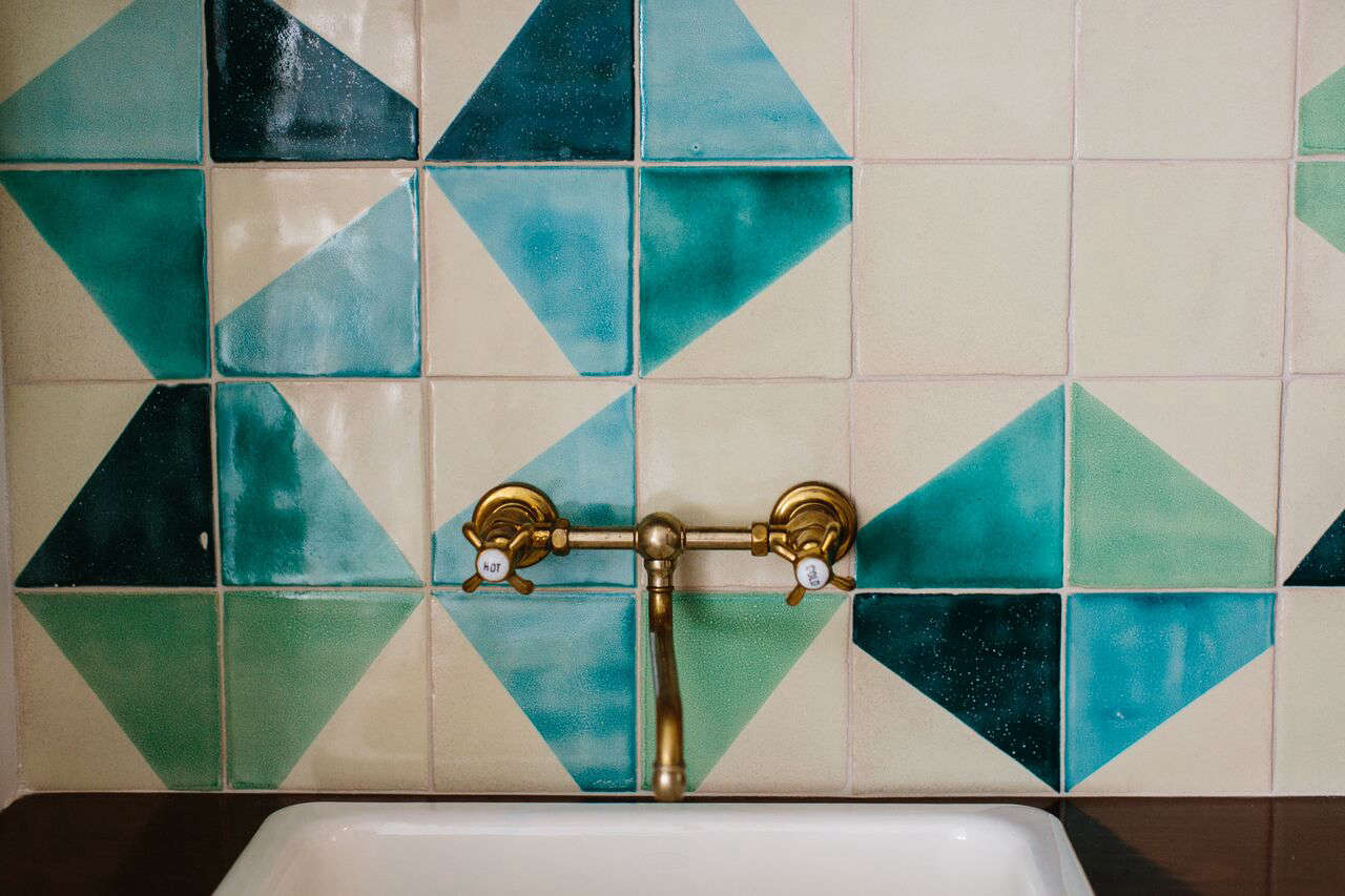 The wet bar backsplash is made of silk-screened tiles by Smink Things inEast London.