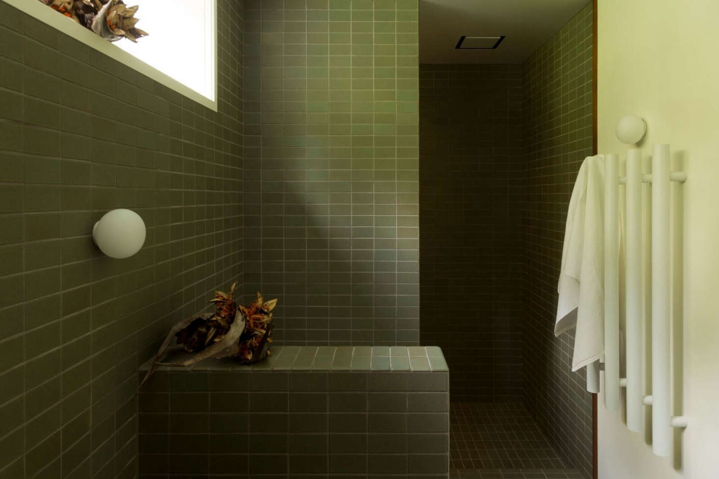 Bathroom of the week two bath remodels with bold green tile in the baths toilet is just beyond the half wall and the showeralso fitted dailygadgetfo Choice Image