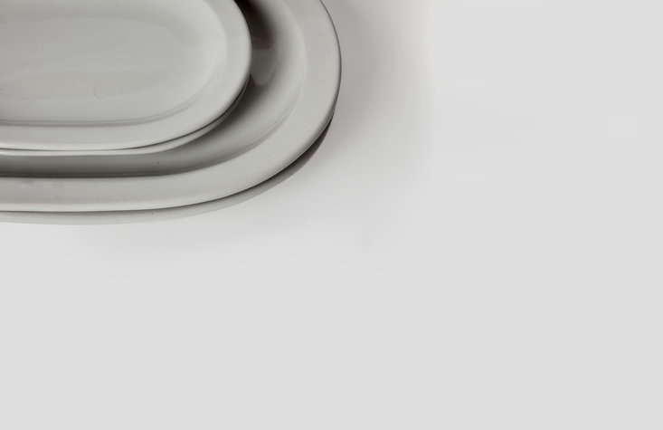 A detail of the platters. The collection is made of heavy, dishwasher-safe stoneware with a pale gray glaze.