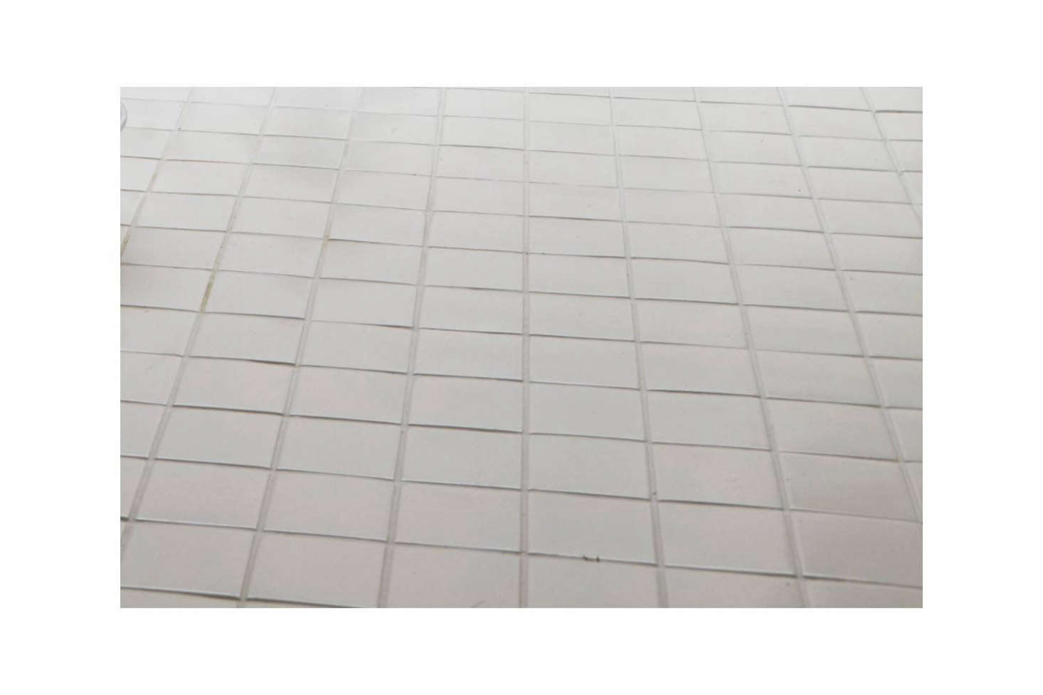 The tile is Earthenware Elements 10-by-10-centimeter (about 4-by-4-inch)Gloss Field Tile in Candle White from Ann Sacks.