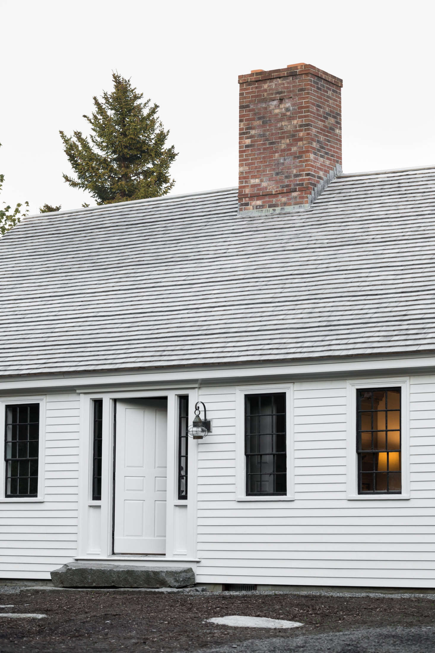 The exterior is traditional New England, modified: Esteves sourced roof shingles from Ben Butler, a local sawyer, but&#8