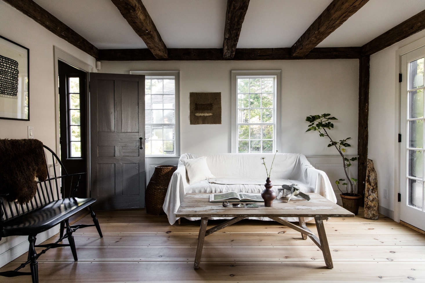 The living area. Throughout, Esteves painted the walls in plaster and old-fashioned milk paint, with trim in Benjamin Moore&#8