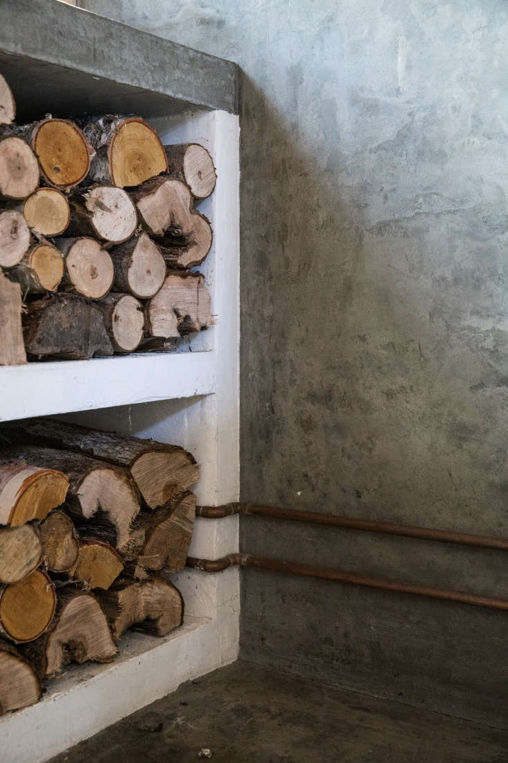 Soot House Stacked Wood in Kitchen by Anthony Esteves on Spruce Head in Maine, Photo by Greta Rybus