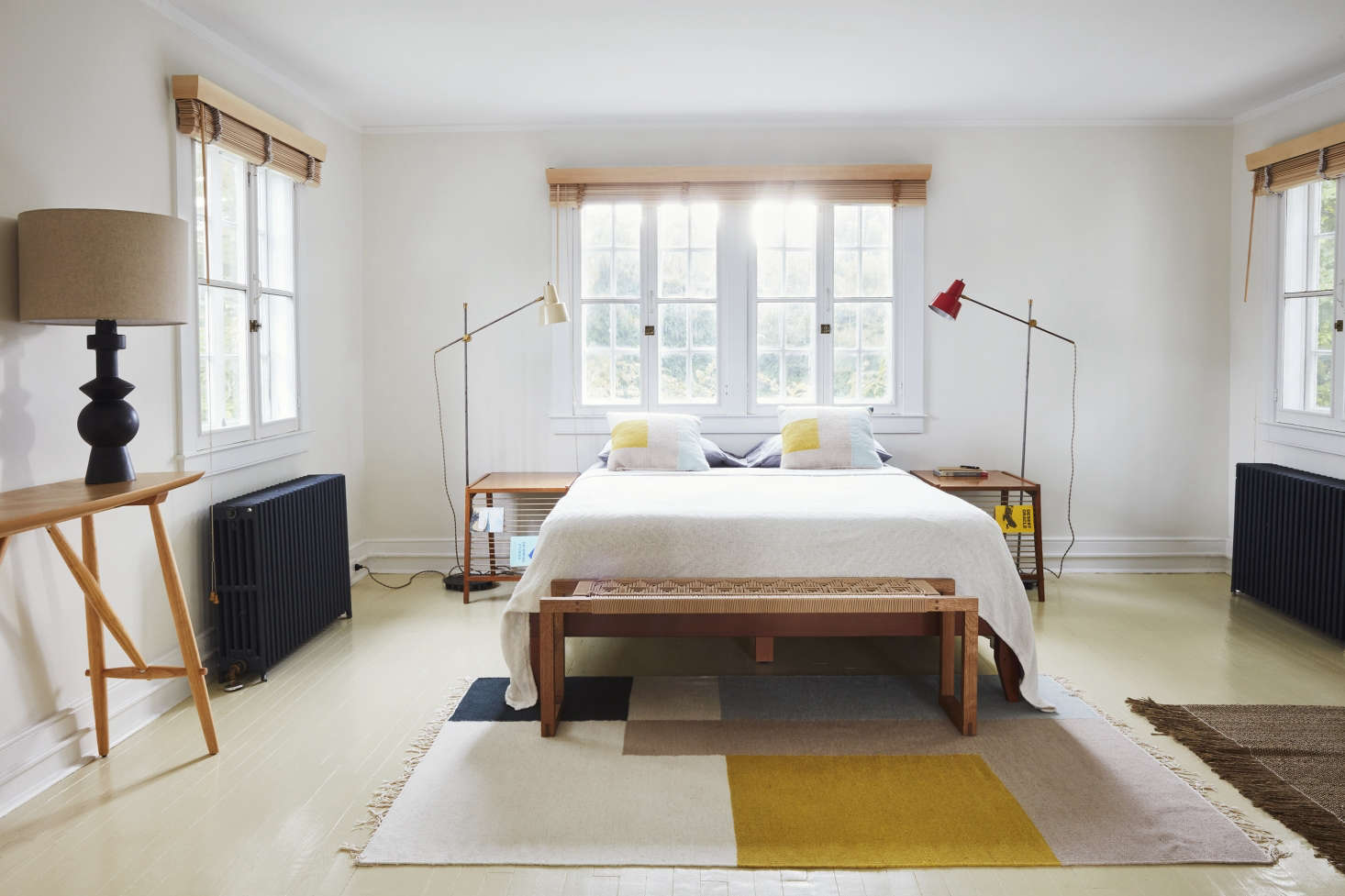 Designer C. S. Valentin preserved the original yellow-painted wood floors in the bedroom of a sea captain&#8